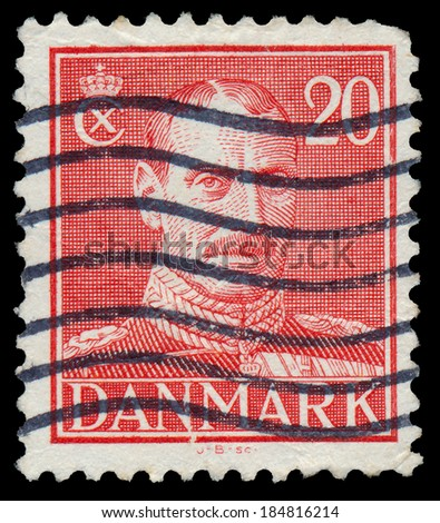 DENMARK - CIRCA 1942: A stamp printed in Denmark shows King Christian X, circa 1942.  - stock photo