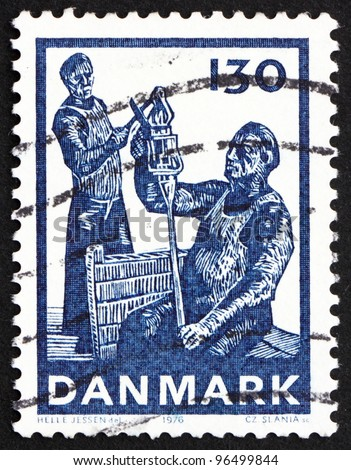 DENMARK - CIRCA 1976: a stamp printed in the Denmark shows Glass Cut off from Foot, Danish Glass Production, circa 1976