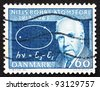 DENMARK - CIRCA 1963: A stamp printed in the Denmark shows Niels Bohr and Atom Diagram, 50th anniversary of atom theory, circa 1963 - stock photo