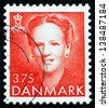 DENMARK - CIRCA 1990: a stamp printed in the Denmark shows Queen Margrethe II, Queen of Denmark, 10th Anniversary of Accession, circa 1990 - stock photo