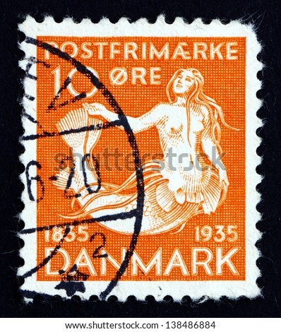 DENMARK - CIRCA 1993: a stamp printed in the Denmark shows The Little Mermaid, Centenary of the Publication of the Earliest Installment of H. C. Andersen'??s Fairy Tales, circa 1993 - stock photo