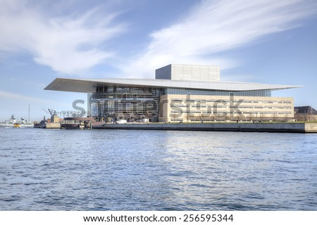 DENMARK, COPENHAGEN - May 03.2013: Large modern opera theater ashore channel in city