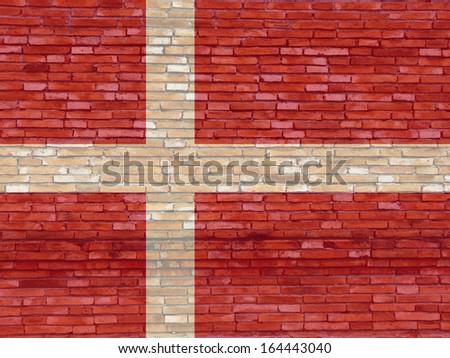 Denmark flag on texture brick wall. - stock photo
