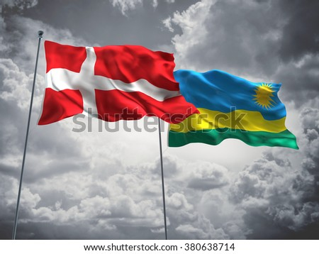 Denmark & Rwanda Flags are waving in the sky with dark clouds