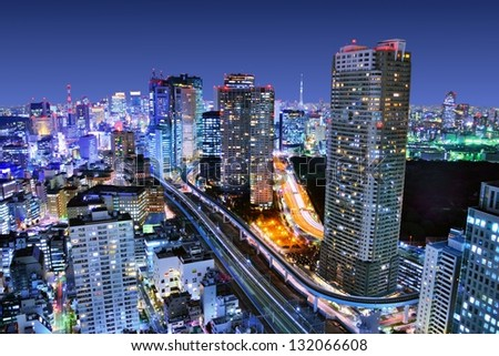Dense buildings in Minato-ku, Tokyo Japan with Tokyo Sky tree visible on the horizon. - stock photo