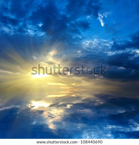 dense clouds sunset over a lake - stock photo