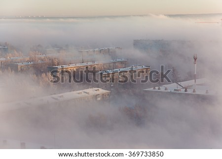 Dense morning fog moves with the Ob river and the Novosibirsk envelops. Winter. Novosibirsk. Russia. - stock photo