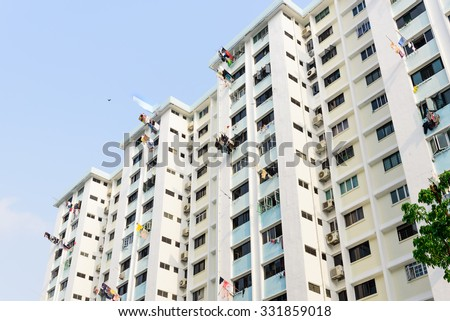 Dense of HDB housing flats with sun drying hanging clothes line in Singapore. Urban concept - stock photo