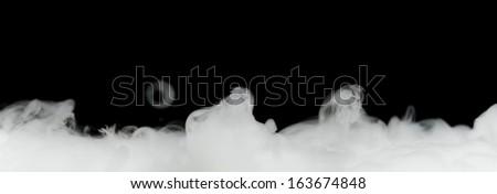 dense smoke isolated on black - stock photo
