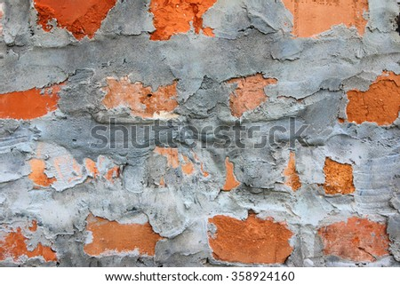 Densely cemented ground birick wall - stock photo