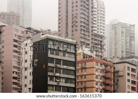 densely packed tower blocks in Hong Kong - stock photo