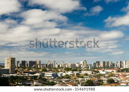 Densely situated homes and buildings exist in Honolulu on the island of Oahu - stock photo