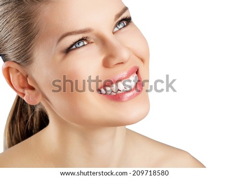 Dental and health care. Close-up portrait of beautiful woman with white fresh toothy smile isolated over white background.