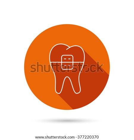Dental braces icon. Tooth healthcare sign. Orthodontic symbol. Round orange web button with shadow. - stock photo