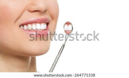 Dental care and inspection. Close-up of woman healthy white smile with mirror. Dentist visit concept.  - stock photo