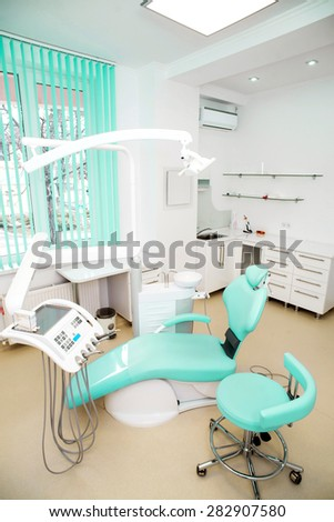 dental clinic interior design with chair and tools.