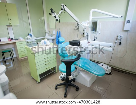 Dental clinic interior design with chair and tools. Dental chair, equipment and other accessories used by dentists. Dentistry