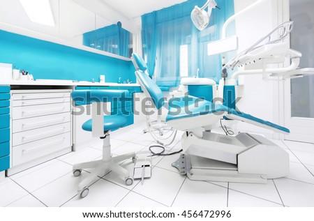 Dental clinic interior modern blue dentistry stock photo royalty free 456472996 shutterstock for Dental clinic interior design concept