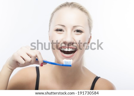 Dental Concepts. Smiling Caucasian Woman With Toothbrush. Horizontal Image