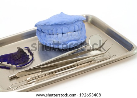 Dental gypsum models and dental brace (Retainer) in medical tray - stock photo
