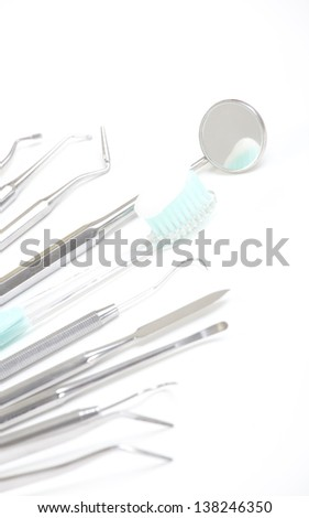 dental health care, toothbrush and mirror - stock photo