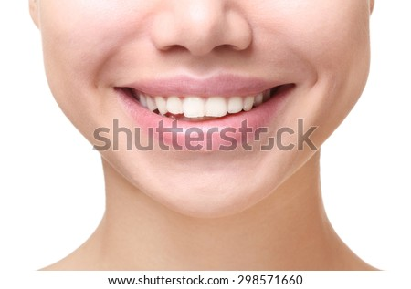 Dental health. Part of face,young woman close up smile. - stock photo