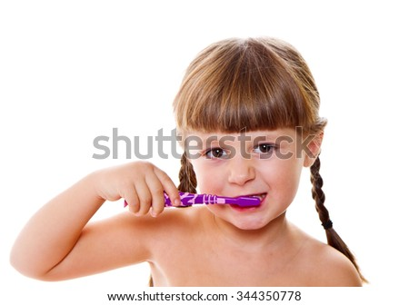 dental hygiene. happy little girl brushing her teeth - stock photo
