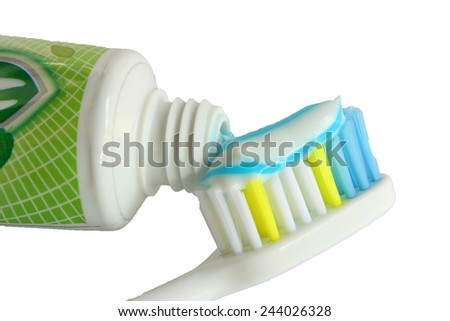 Dental hygiene with a toothpaste on a toothbrush. - stock photo