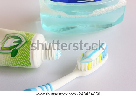 Dental hygiene with a toothpaste on a toothbrush and rinse. - stock photo