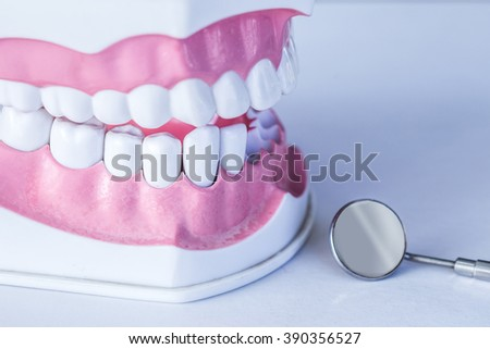 Dental instruments on white background