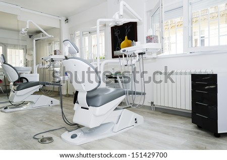 Dental office with two dental chairs - stock photo