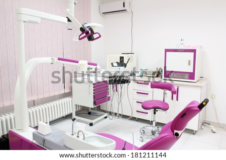 dental practice with chair and equipment - stock photo