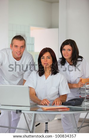 Dental team at a laptop