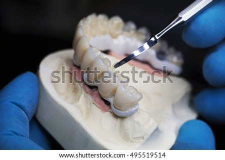 Dental technician applied glaze on ceramic crown