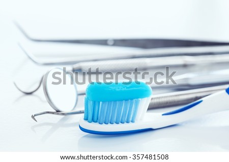 Dental tools and toothbrush - stock photo