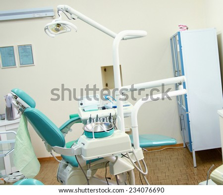 Dental tools on a dentist's chair - stock photo