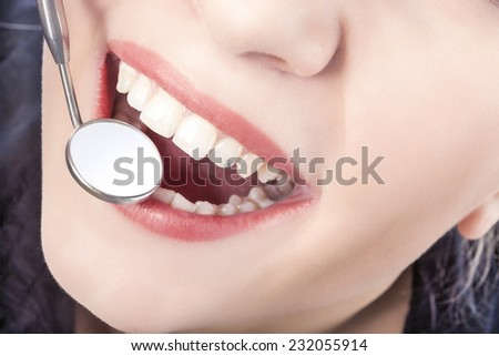 Dental Treatment with Mouth Mirror of Young Caucasian Female During Her Oral Examination. Horizontal Image - stock photo