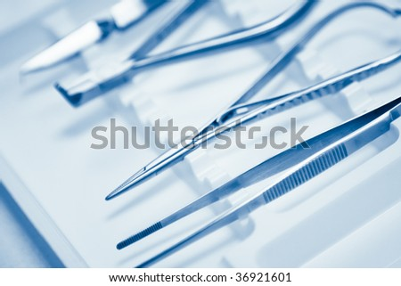 dentals tools with shallow depth of field - stock photo