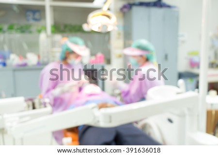 Dentist and Dental assistants in hospital ( blurry dental background ) in thailand