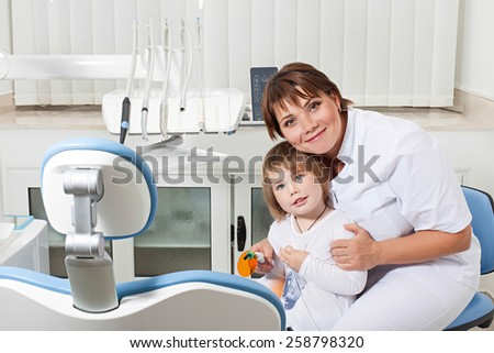 dentist and patient happy looking at the camera and smiling