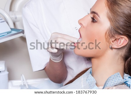 Dentist carrying out a thorough examination. Female patient