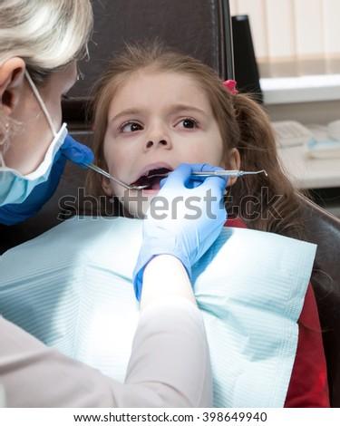 Dentist, Child, Dental Hygiene. - stock photo