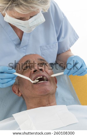 Dentist curing a patient - stock photo