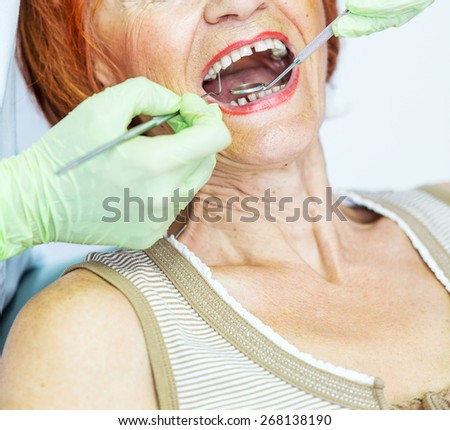 Dentist examining patient. Shallow depth of field. Dentist tools.  - stock photo