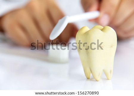 dentist holding dental Mirror, dental hygiene concept - stock photo