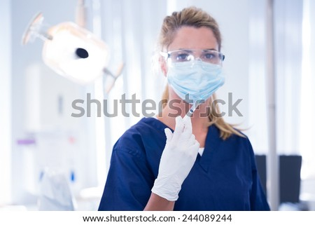 Dentist in mask and glove holding an injection at the dental clinic - stock photo