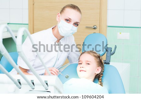 dentist inspects the child, visiting the dentist - stock photo