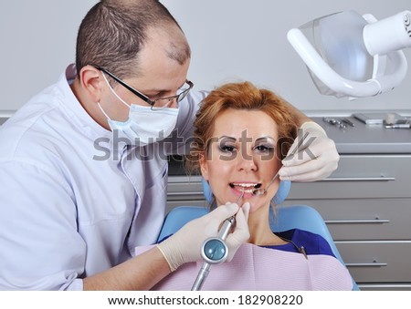 dentist makes cleaning a patient's teeth, close up