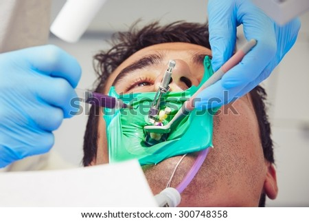 Dentist office - young man in the dentist chair