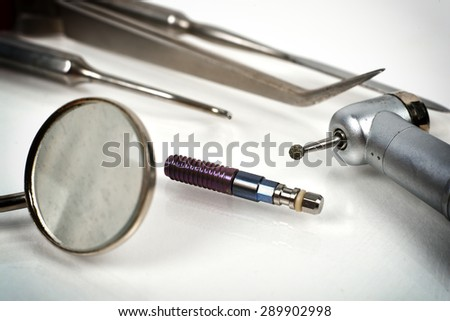Dentist's medical equipment tools and dental implant - stock photo